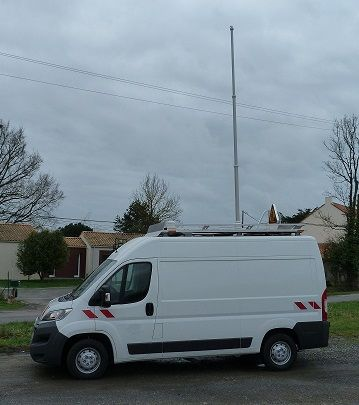 Overall view. Telescopic mast with device of high voltage overhead electric lines