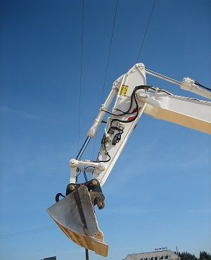 Hydraulic excavator for detection of high voltage overhead electric lines